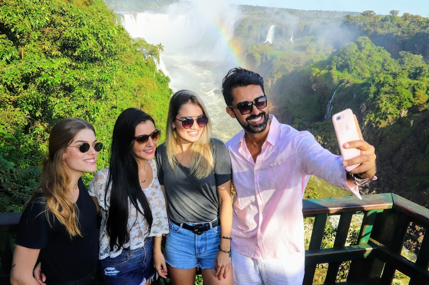 Show item 1 of 10. Group taking a selfie with a mobile phone at  Iguassu Falls