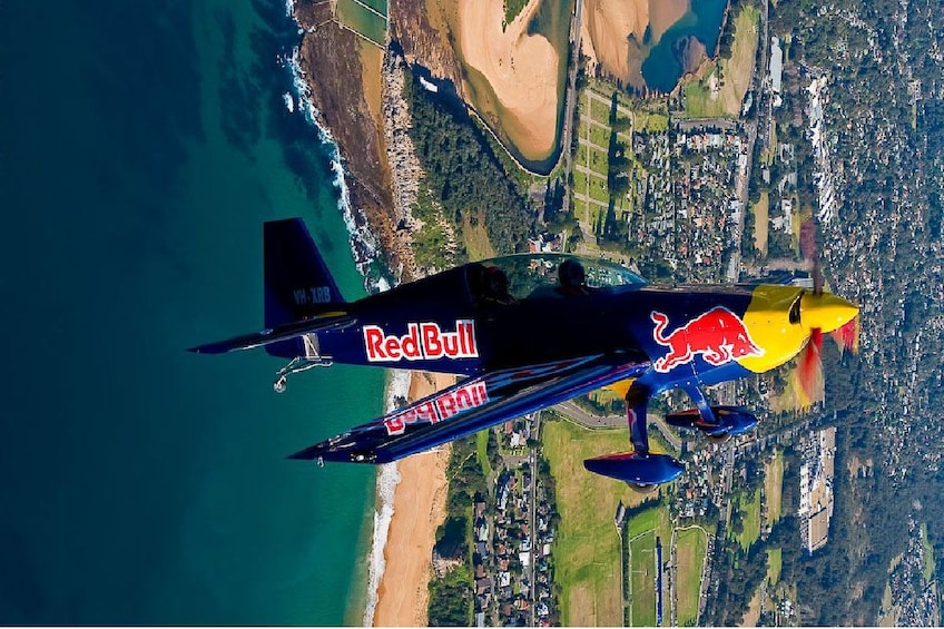 Show item 2 of 4. Small airplane over Sydney