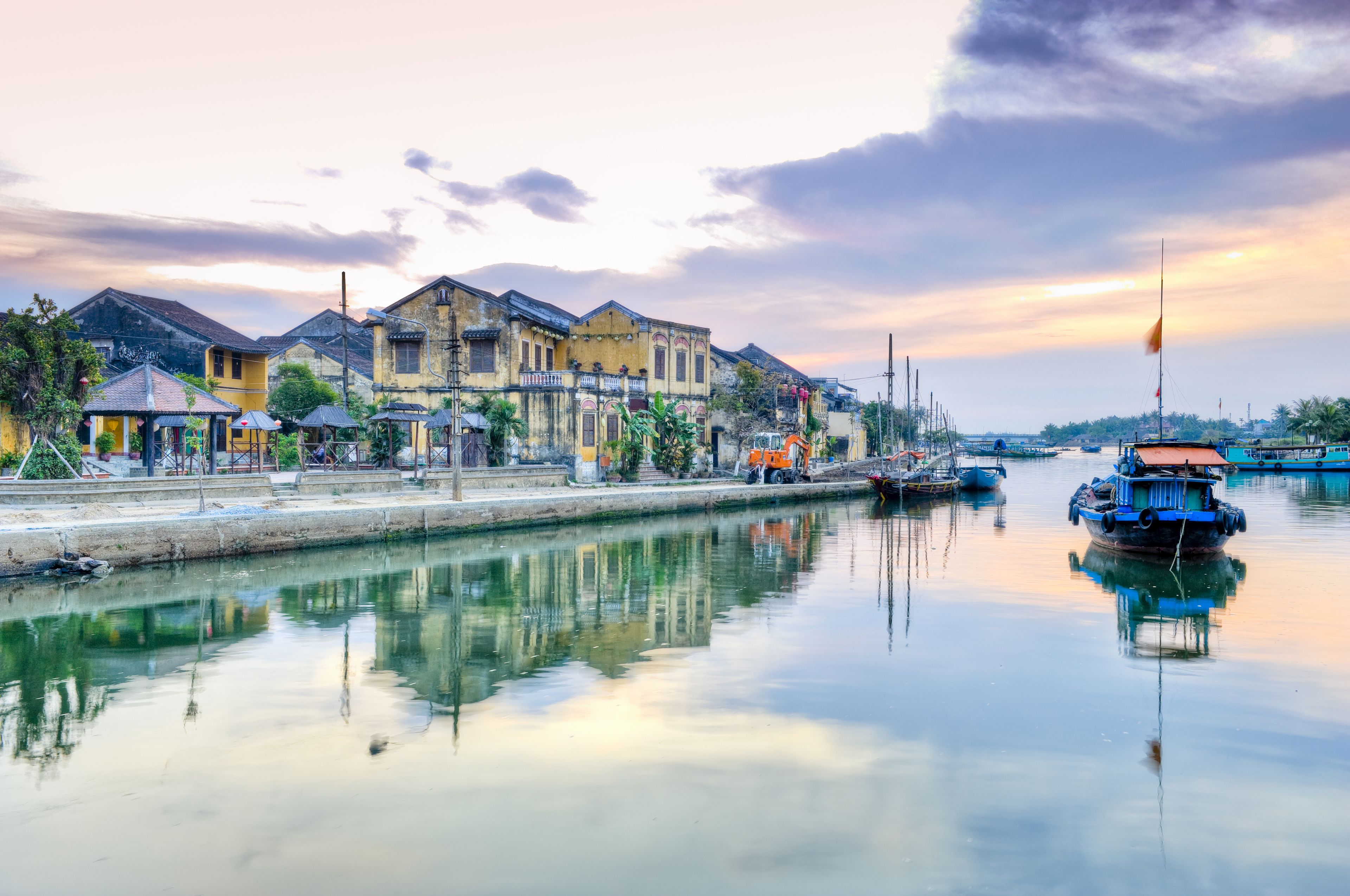 Vietnam - Hoi An - Wide view of a boat and a couple of buildings reflected in water.jpg