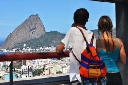Tourists look out at Corcovado Mountain in Brazil