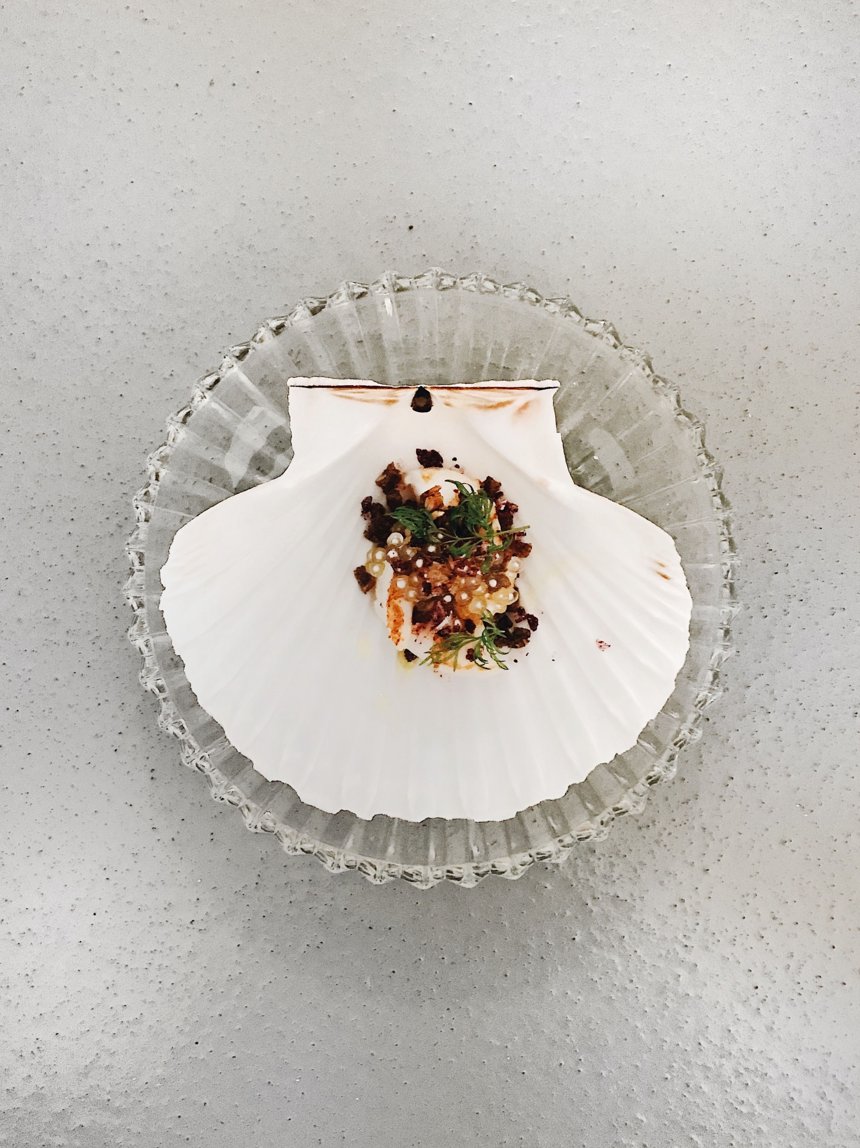 Caviar dish served on a clam shell
