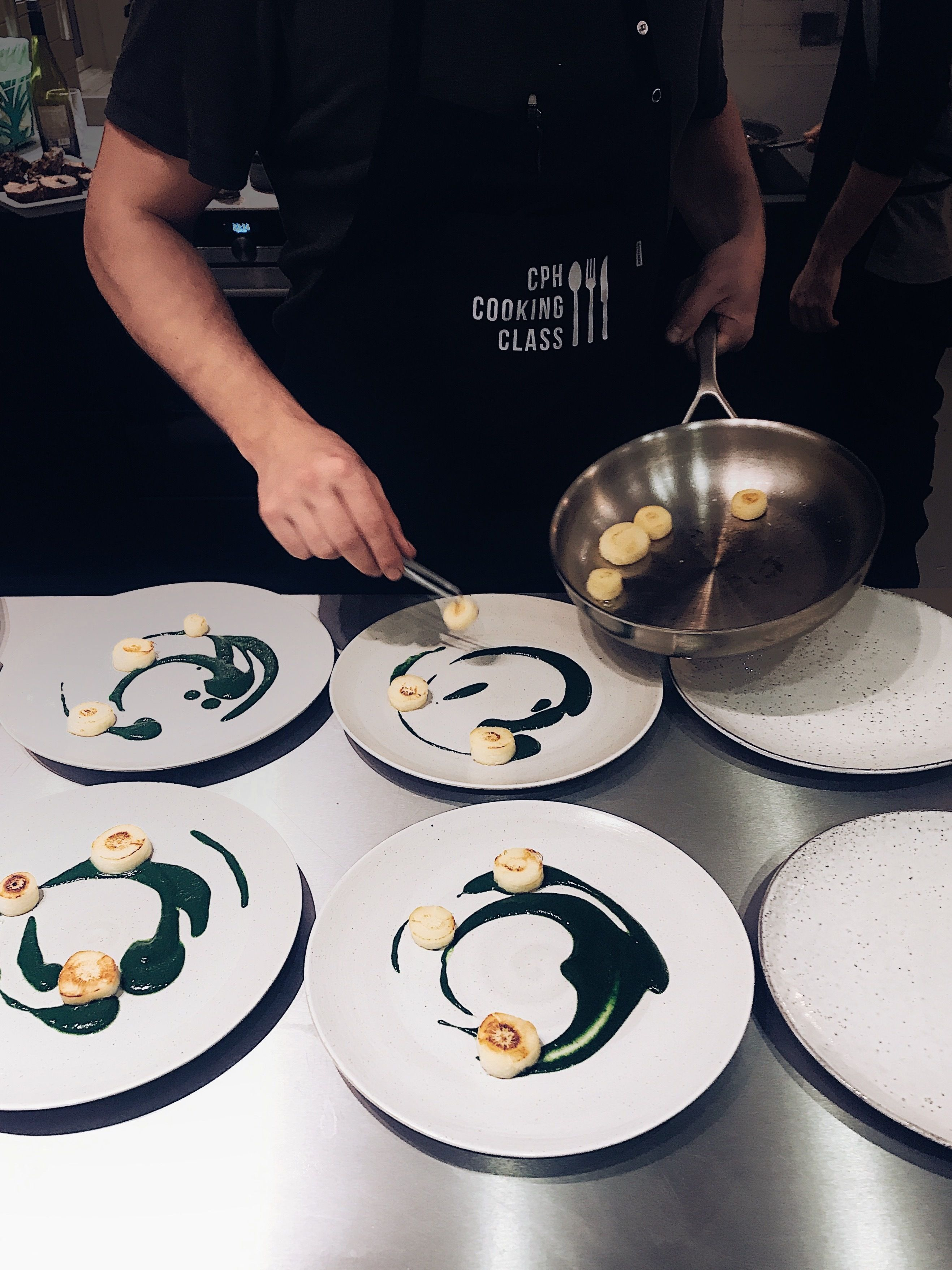 Plating dishes in a Nordic Cooking class