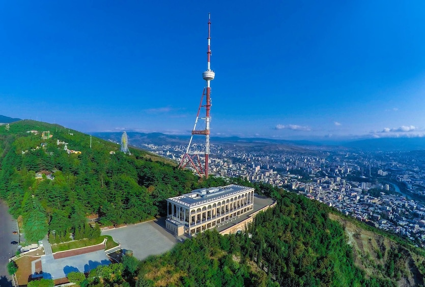 Show item 1 of 4. Building at top of a mountain in Tbilisi