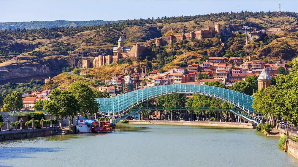 Show item 4 of 4. Bridge of Peace pedestrian bridge over Kura River in Georgia