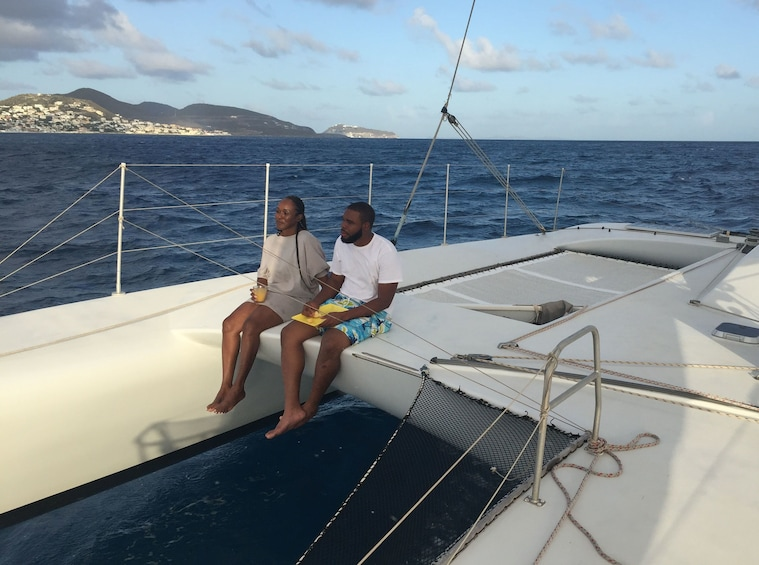 Show item 3 of 9. Couple of people on a trimaran sailboat in St Barthelemy