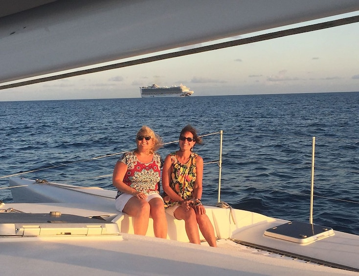 Show item 9 of 9. Couple of women on a trimaran sailboat in St Barthelemy
