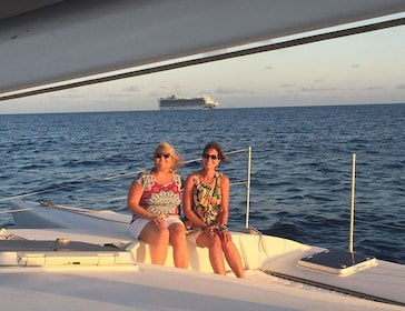 Couple of women on a trimaran sailboat in St Barthelemy
