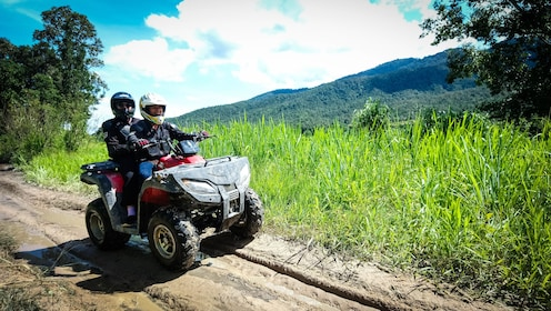 Couple on an ATV in Huay Tung Tao