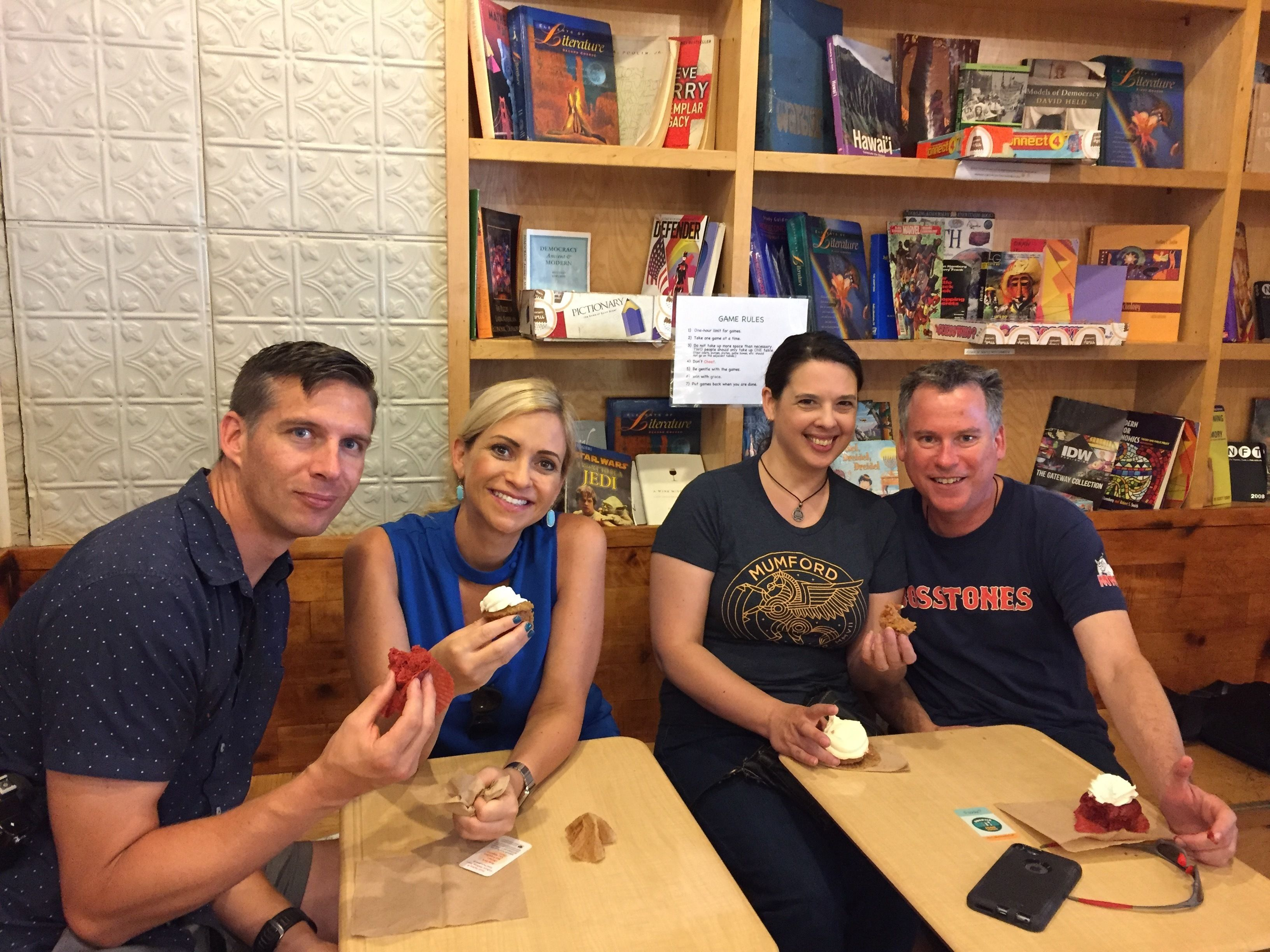 Group having cupcakes in New York