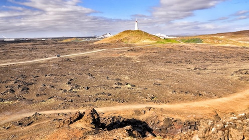 Field and lighthouse in Reykjanes