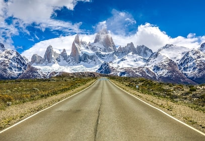Road in Patagonia leading towards snowy mountains