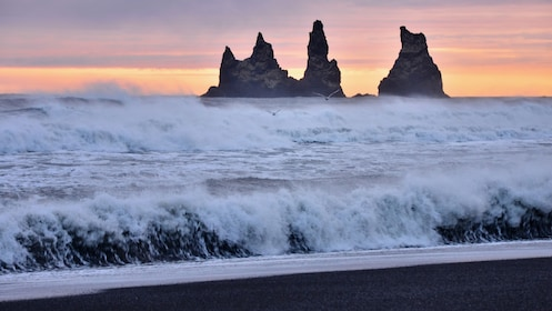 Waves and rock formations on a windy day on the beach in Iceland