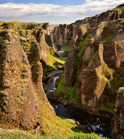 River winding through tall rock formations in Iceland