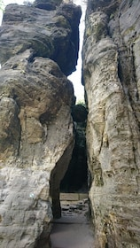 Narrow path through tall rock formations in Switzerland