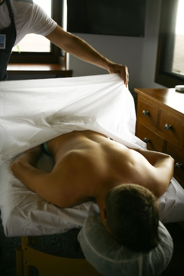Show item 3 of 7. Man getting a massage on Hawaii Island