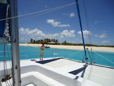 Girl on the deck of a catamaran sailboat in Anguilla