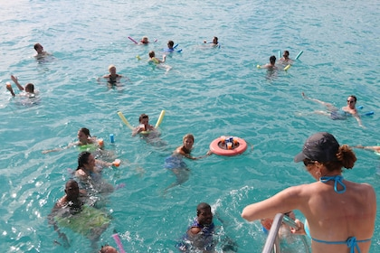 Tour group swimming and drinking cocktails in Anguilla