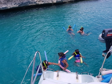 People jumping off catamaran into the water in Anguilla