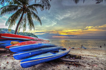 Boats on the shore at sunset at Port Dickson