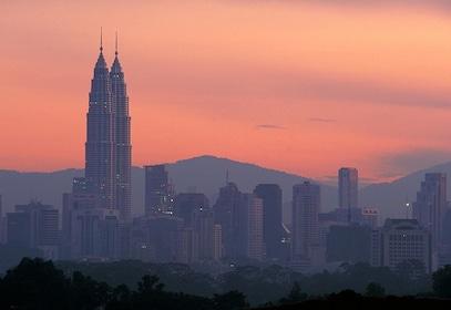 Sunset view of the Petronas Towers in Kuala Lumpur, Malaysia