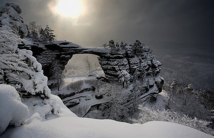 Rock arch covered in snow in the mountains of Switzerland