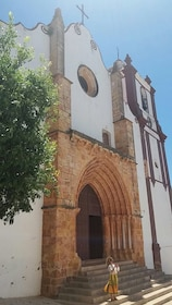 Woman in front of church in Portugal