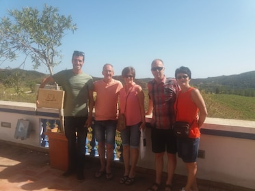 Tour group outside a winery with vineyard in the background in Portugal