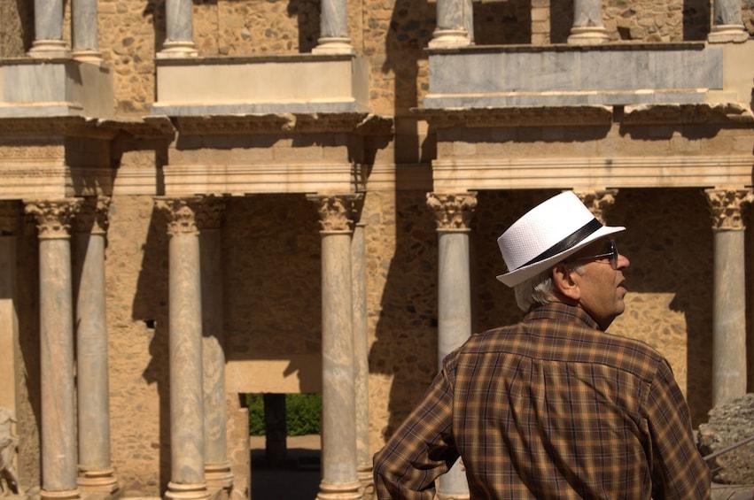 Man looking at ruins in Merida