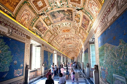 Visitors inside the Vatican Museums