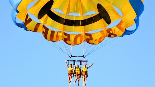 Three people parasailing in Miami