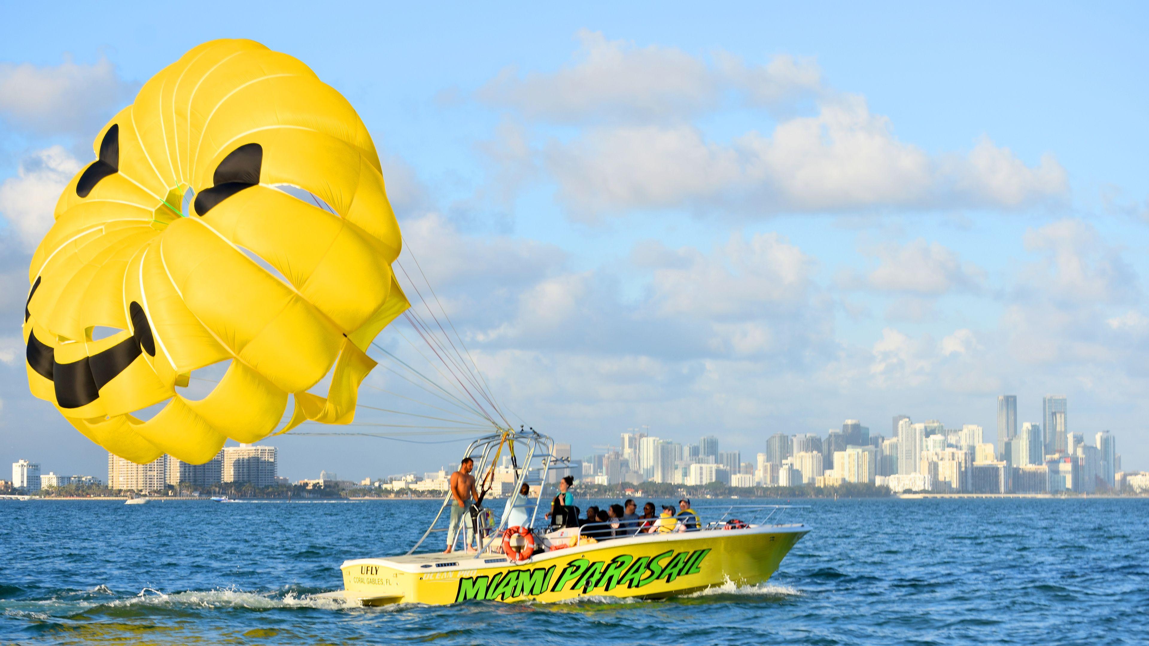 Parasailing boat dragging a happy face parachute