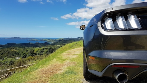 Convertible parked on top of a scenic viewpoint in New Zealand