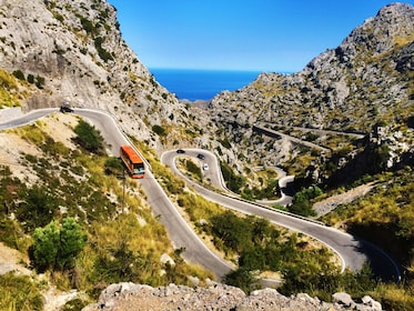 Bus on a winding mountain road in Mallorca
