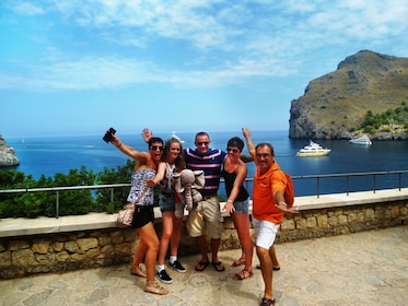 Group posing for a photo on the coast of Mallorca