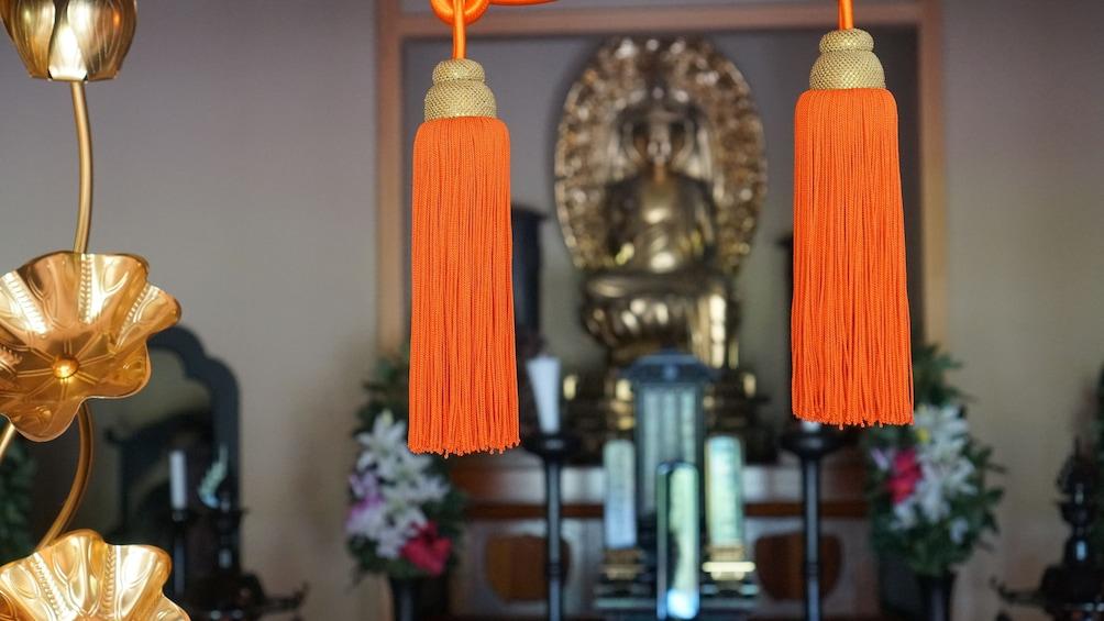 Two hanging bunches of orange silk in yoga studio