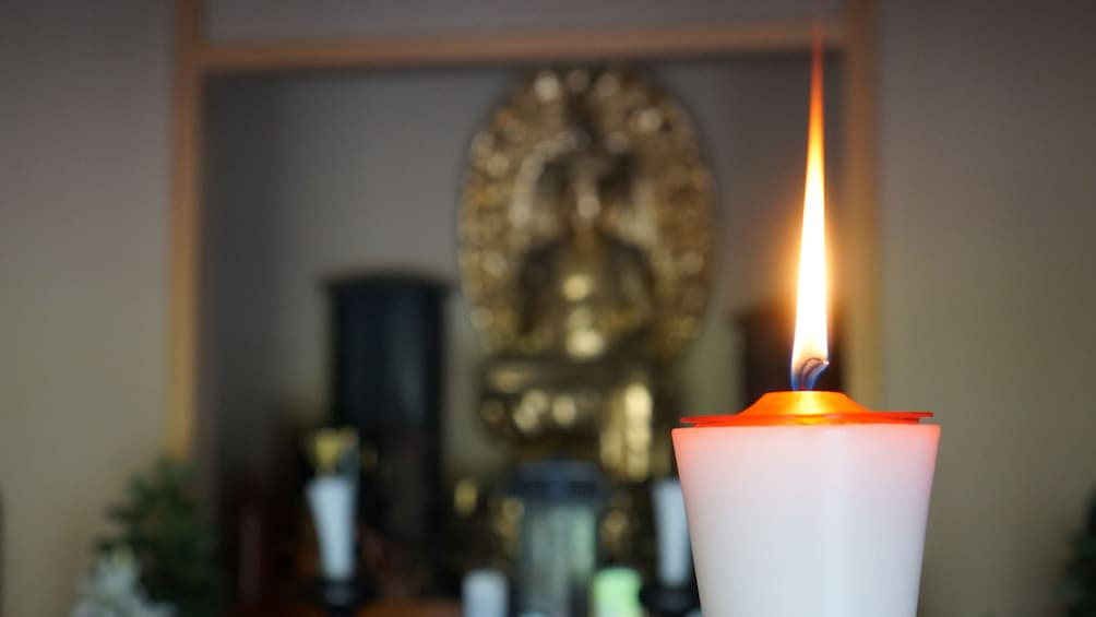 White lit candle in yoga studio in Kyoto, Japan