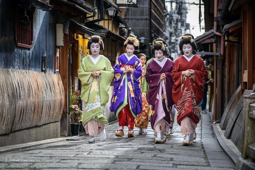 Four women dressed as Geishas