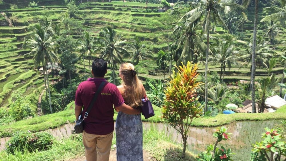 Show item 3 of 8. Couple looking out at terraced field in Bali