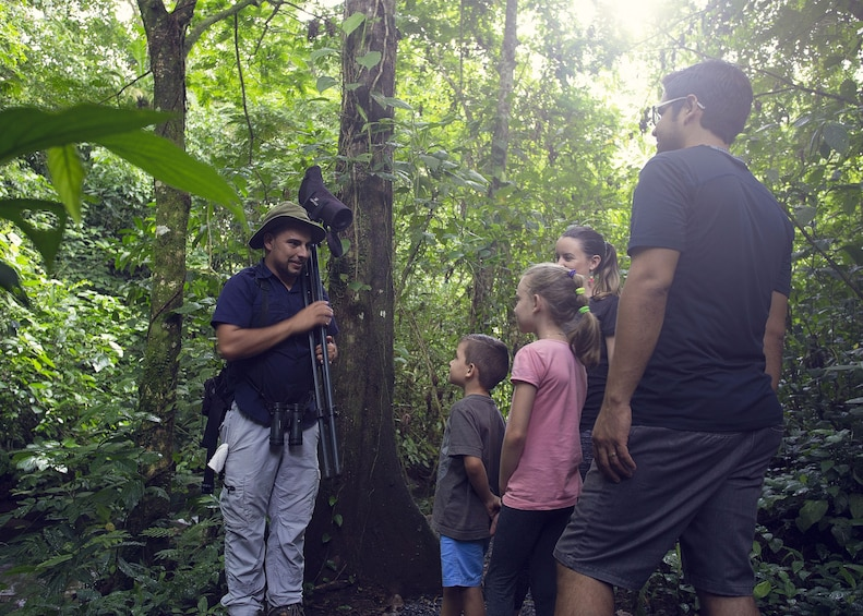 Show item 6 of 6. Guide speaks to family in La Fortuna Forest in Costa Rica