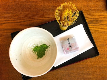 Bowl with green tea powder and brush