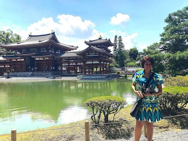 Woman stands outside a Pagoda in Kyoto