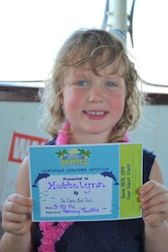 Child holding a certificate while on the Dolphin Exploration Tour in Clearwater