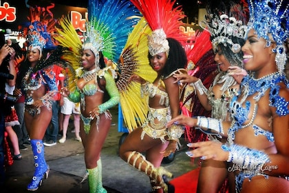 Dancers in colorful costumes at a dinner show in Brazil