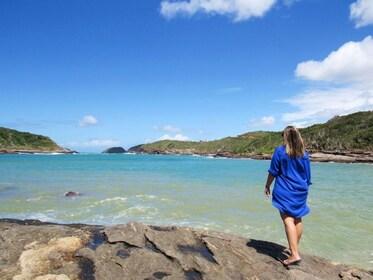 Woman walking on the rocks on the coast of Buzios