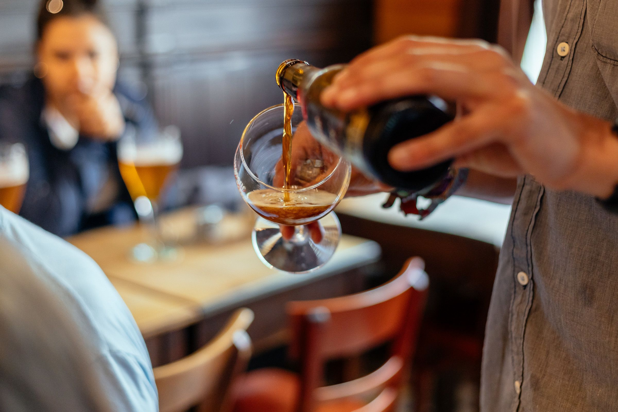 Belgian beer being poured at a local bar in Bruges