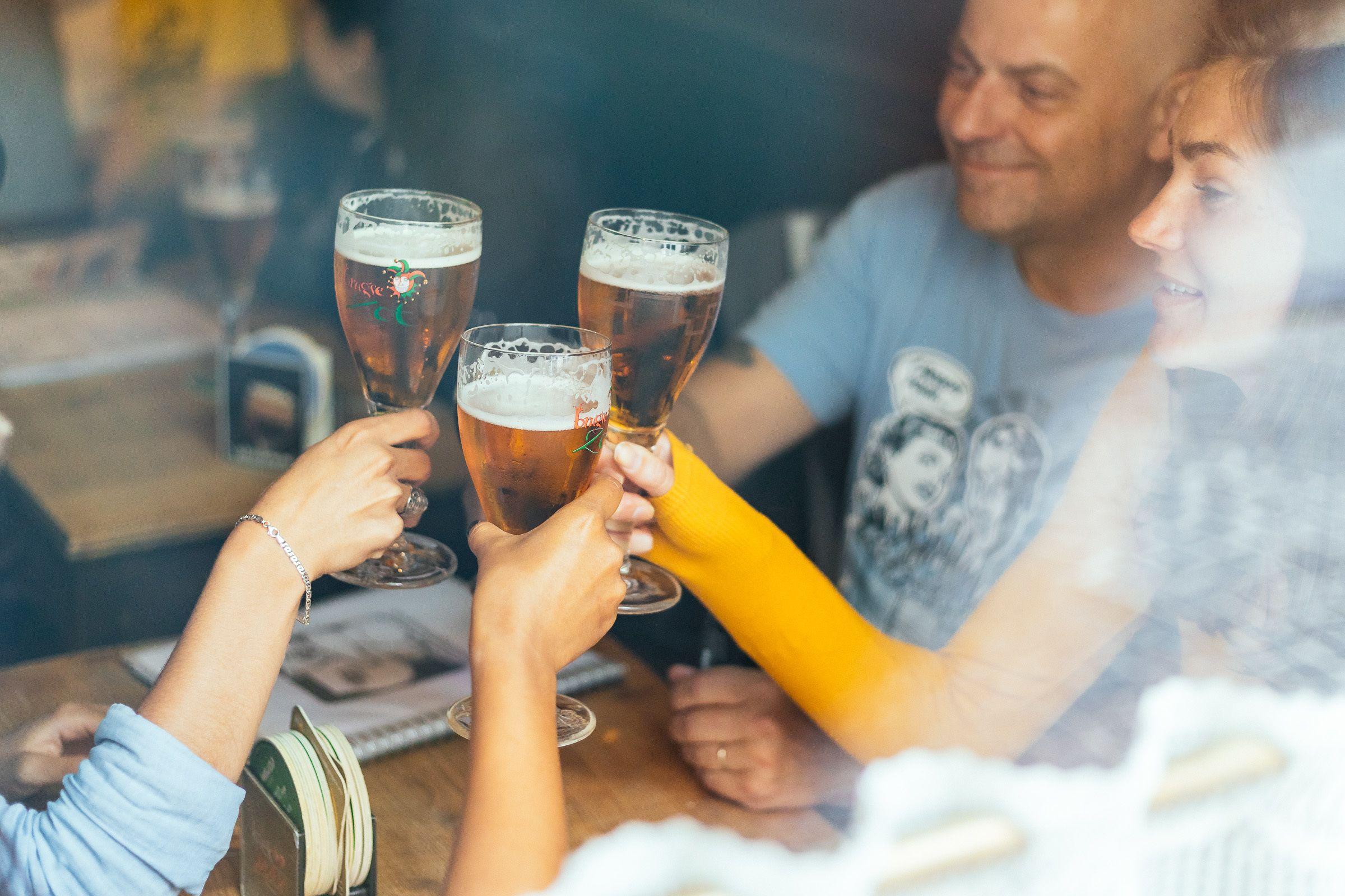 Group enjoying Belgian beer in Bruges
