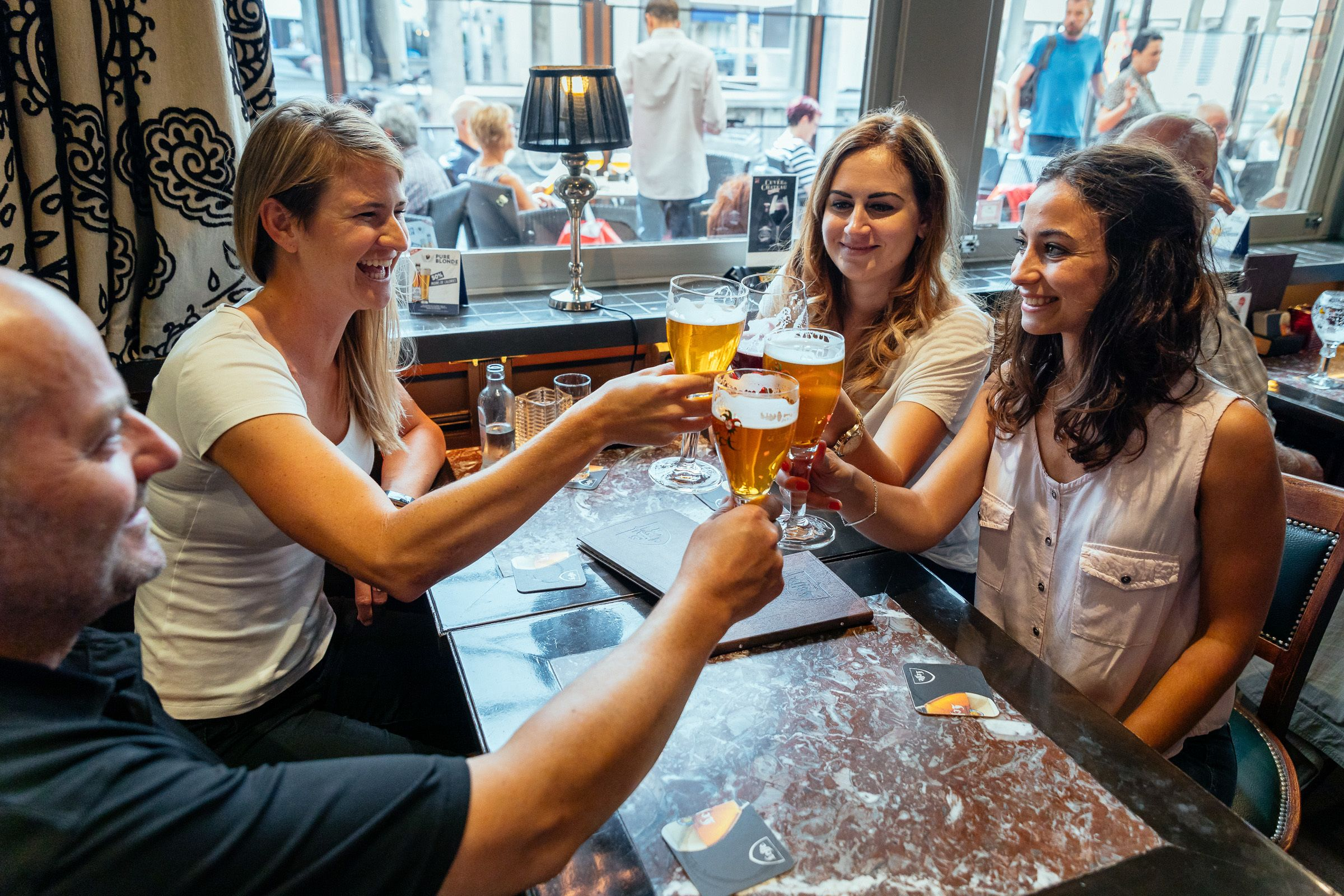 Group enjoying Belgian beer at a local pub in Bruges