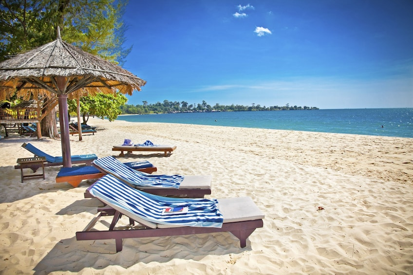 Show item 1 of 5. Lounge chairs on a beach in Sihanoukville