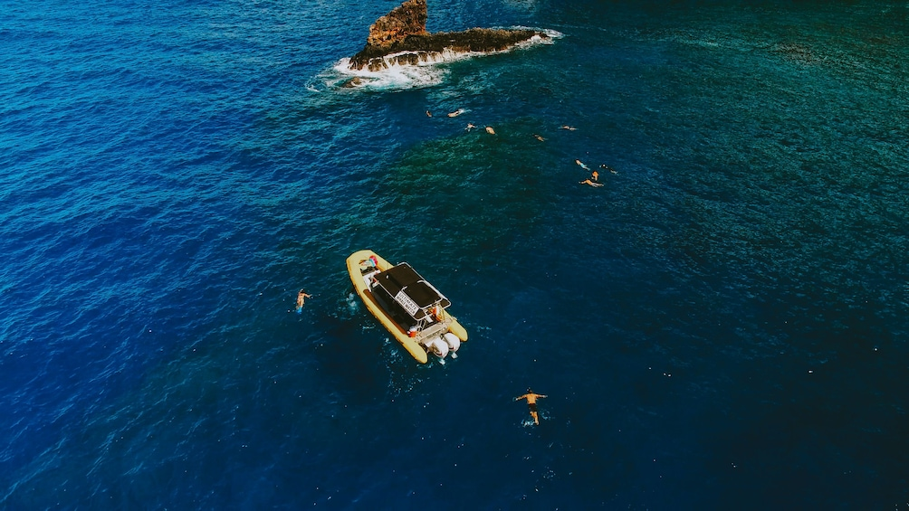 Show item 1 of 10. Aerial view of small boat with snorkelers