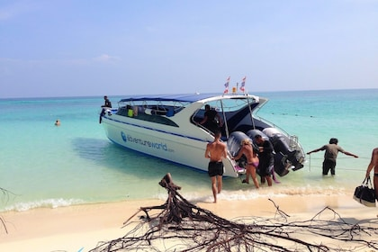 People boarding a boat on a beach on Phi Phi Island